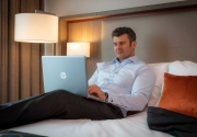 business-traveller-working-in-his-Clayton-Hotel-Chiswick-room