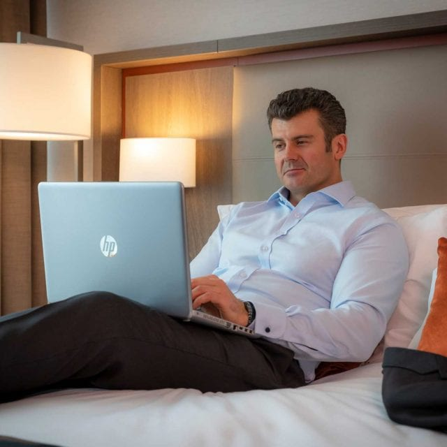 Business traveler working in his Clayton Hotel Chiswick room