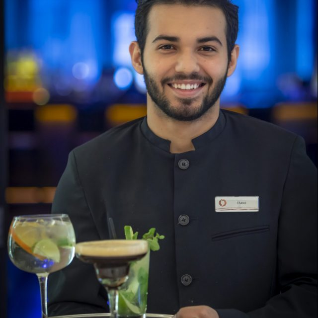 smiling bar staff serving cocktails at Clayton Hotel
